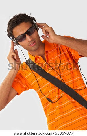 Young Man listening to music with headphones on white background - stock photo