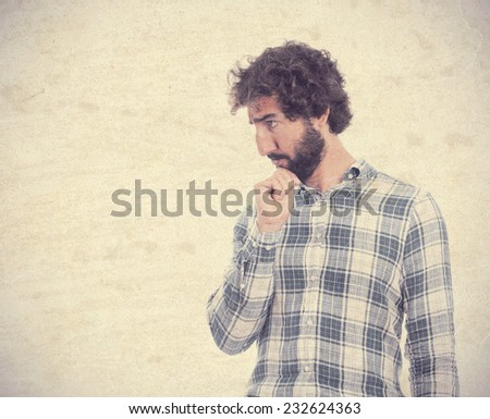 young man looking and thinking - stock photo