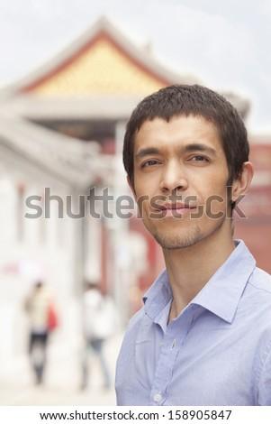Young man looking at camera - stock photo