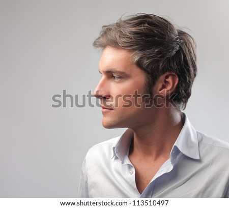 Young man looking at his side - stock photo