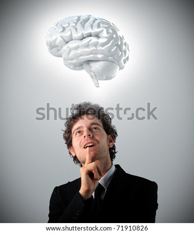young man looking 3d brain - stock photo
