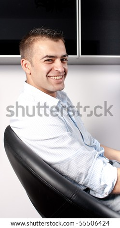 Young man looking into the camera - stock photo