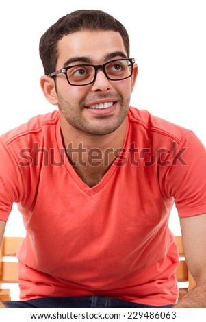 Young man looking up, isolated background - stock photo