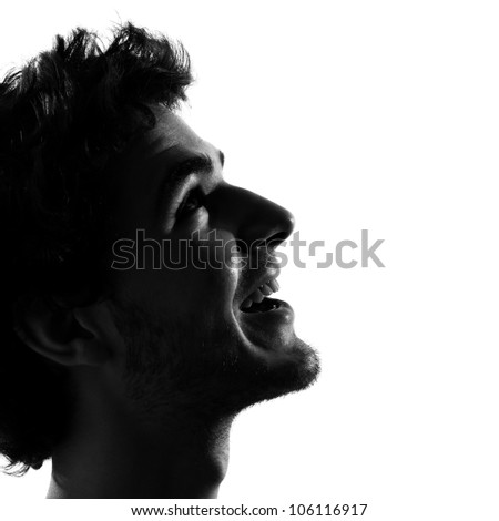 young man looking up smiling happy portrait silhouette in studio isolated on white background - stock photo