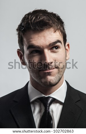 Young man looking up thinking a new idea. - stock photo