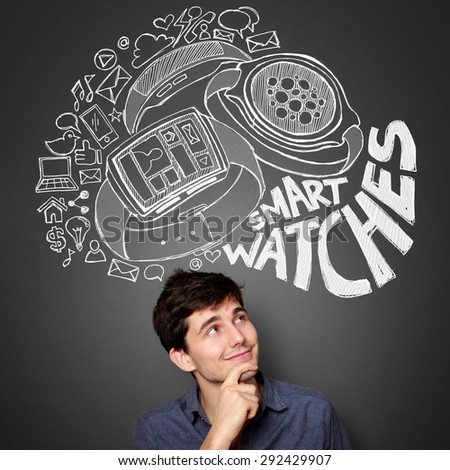 young man looking up to the illustration of the concept of modern smart watch - stock photo
