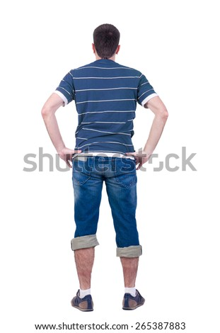 young man looks at  white background. rear view. Isolated over white . - stock photo