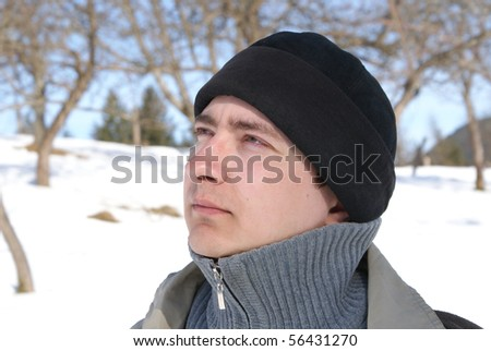 Young man looks into the distance, brooding eyes, directed toward - stock photo