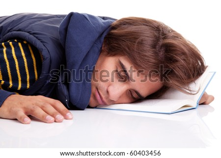 young man lying asleep on a book, isolated on white, studio shot - stock photo
