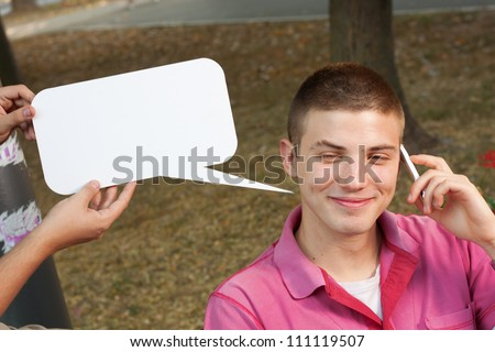 Young man making a call with cell phone - stock photo