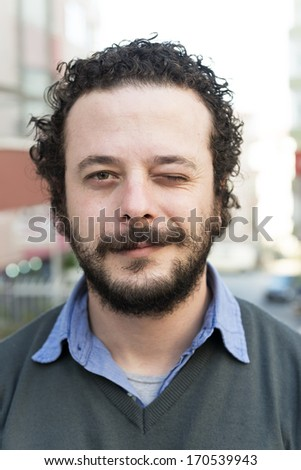 Young man making a funny face - stock photo