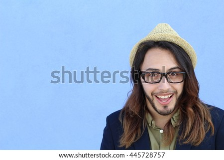 Young man making a funny face with copy space - stock photo