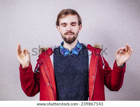 young man meditates - stock photo