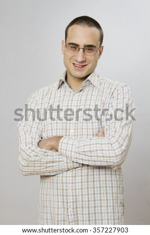 young man (nerd) smiles - stock photo