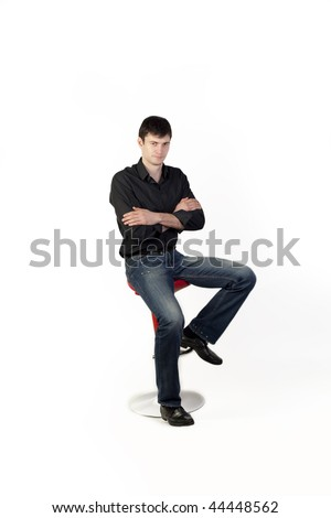 Young man on a chair - stock photo