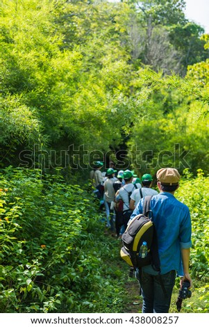 Young man on a field trip in the forest with his friend. Selective Focus. - stock photo