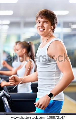 Young man on a treadmill - stock photo