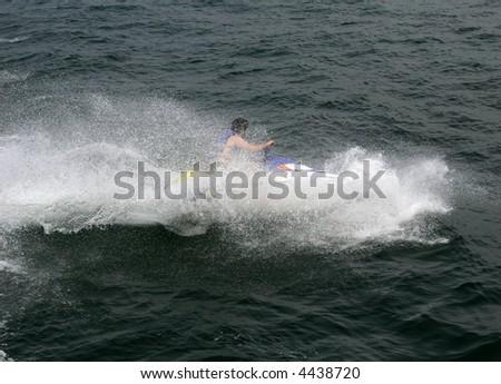 young man on jet ski - stock photo