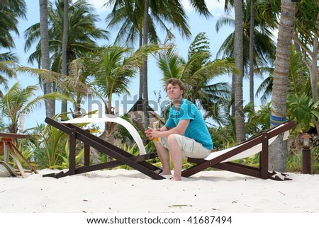 Young man on the beach - stock photo