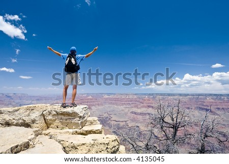 Young man on the top of the Crand Canyon. South rim. Arizona. USA - stock photo