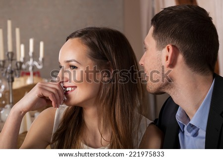 Young man paying a compliment beautiful woman - stock photo