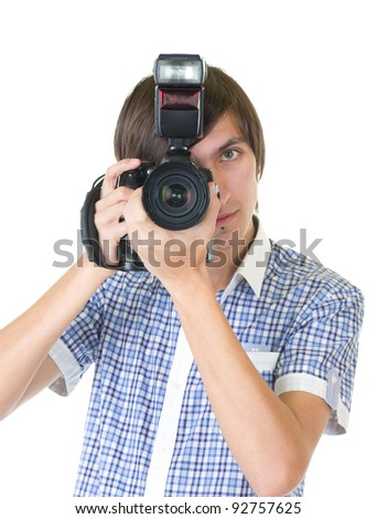 Young man photographer doing photos by digital camera isolated on white background - stock photo