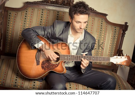 Young Man Playing Guitar,ITALY - stock photo