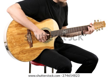 Young man playing on acoustic guitar isolated on white - stock photo