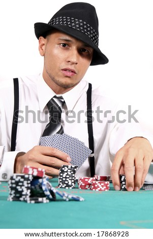 Young Man Playing Poker - stock photo