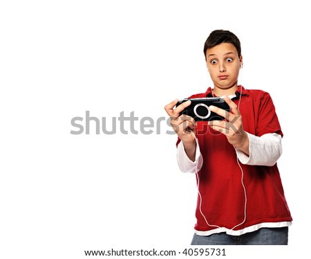 Young man playing videogames - isolated - stock photo