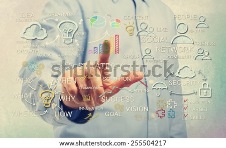 Young man pointing at business strategy concepts  - stock photo
