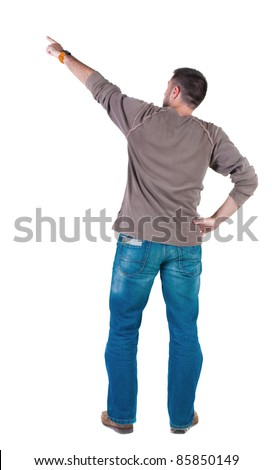 young man pointing at wall. rear view. Isolated over white . - stock photo