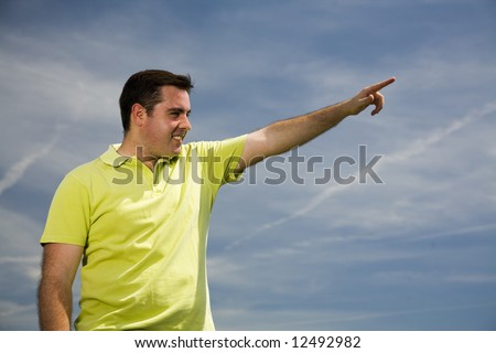 young man pointing forward with his hand - stock photo