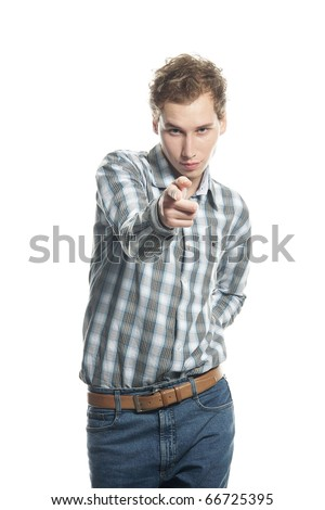 young man pointing over white - stock photo