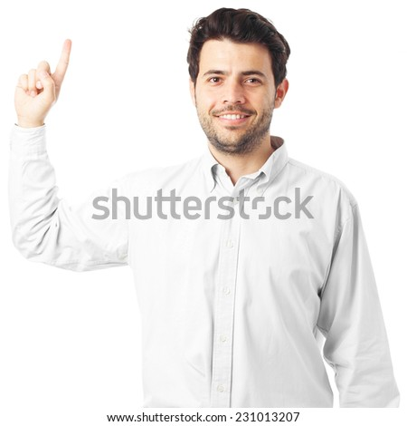 young man pointing up on a white background - stock photo