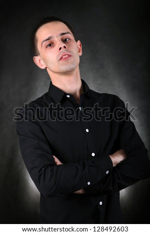 Young Man Portrait on The Black Background - stock photo