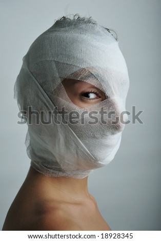 Young man portrait with bandaged face, close up - stock photo