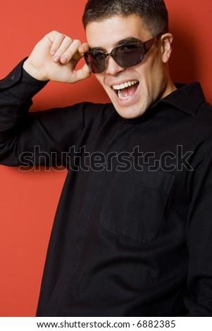 young man portrait with sunglasses, studio shot - stock photo