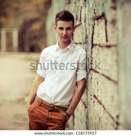 Young man posing outdoors - stock photo