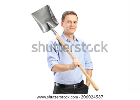Young man posing with a shovel isolated on white background - stock photo