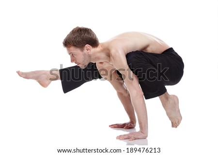 young man practicing yoga on white background - stock photo