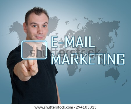 Young man press digital E-mail Marketing button on interface in front of him - stock photo