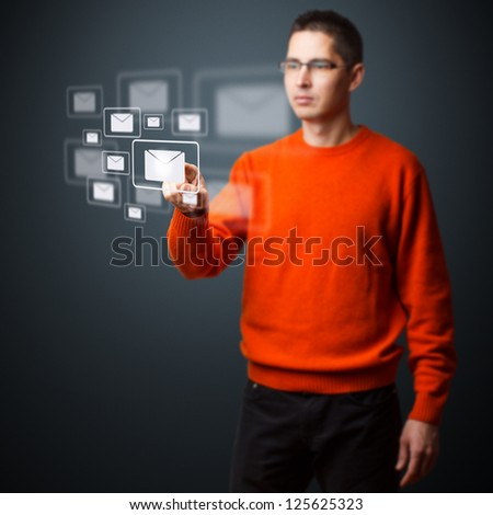 Young man pressing e-mail button - stock photo