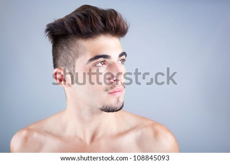 Young man profile with copyspace on grey background - stock photo