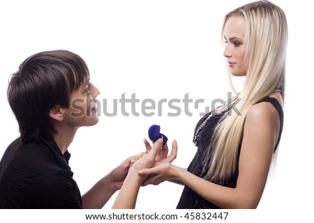 young man propose marriage to beautiful woman - stock photo