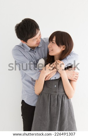 Young man proposing to girlfriend offering engagement ring  - stock photo