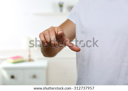 Young man push button - stock photo