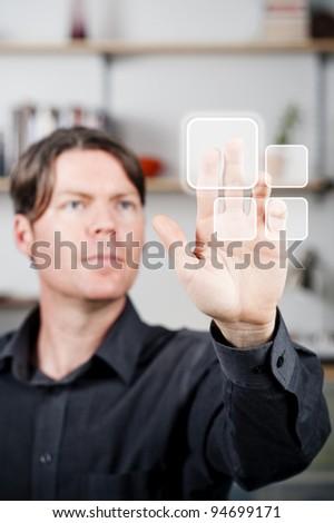 young man pushing a blank digital button - stock photo