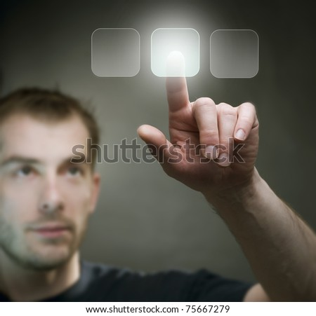 Young Man pushing the button - stock photo
