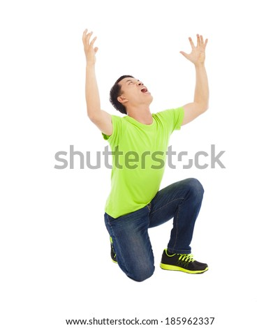 Young man raise hands and screaming - stock photo